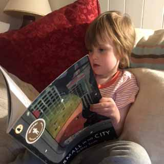 Charlie, 4, reads Small in the City by Sydney Smith