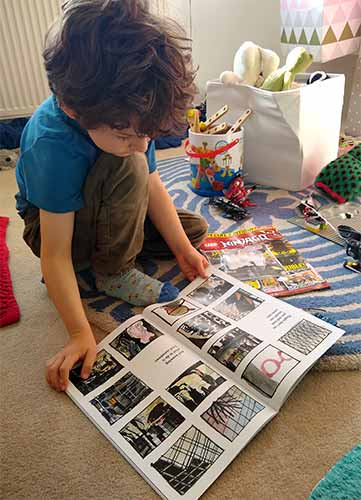 Daniel, 6, reads Small in the City by Sydney Smith